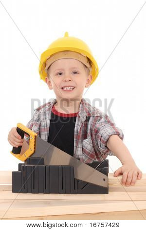 4 years old boy with handsaw isolated on white