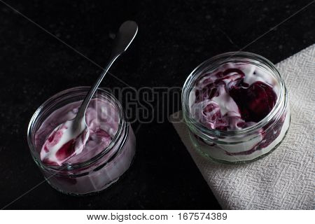 Yogurts With Fruits Assortment In Glass Bowls On Dark Marble Background. Natural And Fruit Healthy,