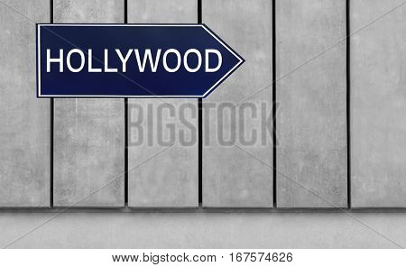 Street sign with word HOLLYWOOD on wooden background