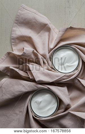 Yogurts Or Cosmetic Cream Assortment  In Glass Jar On Ligth Background. Natural, Healthy, Gourmet De