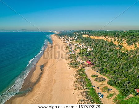 Aerial View Empty Sandy Beach With Small Waves