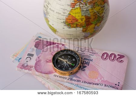Turkish Lira Banknotes By The Side Of A Compass
