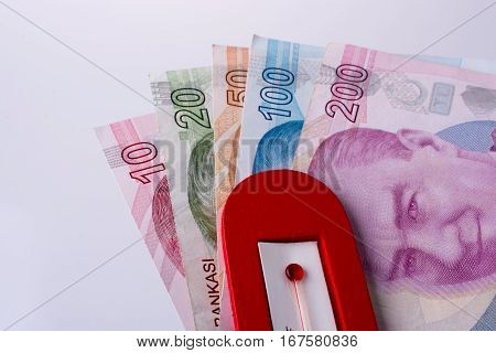 Turkish Lira Banknotes By The Side Of A Red Color Temperature