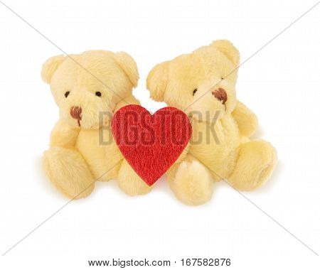 Two teddy bears with red heart isolated over white. Valentine's Day and love concept.