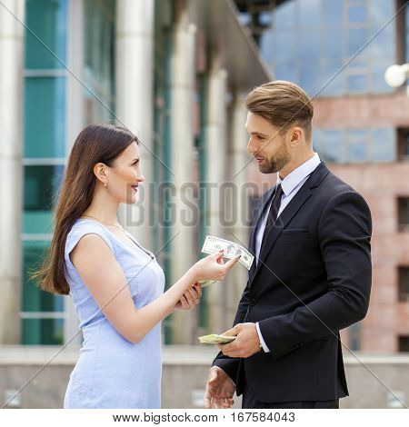 Close portrait of a smiling attractive business young couple working together, outdoor shoot