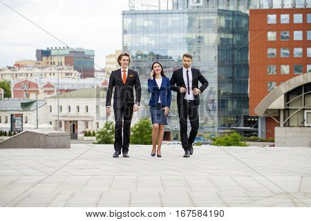 Three Business people walking outside office
