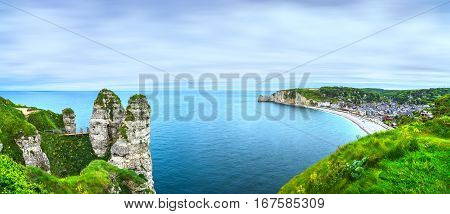 Etretat village and bay beach aerial view from cliff. Normandy France Europe.