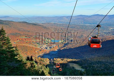 STOWE, VERMONT - OCT 11: Gondola lift and Autumn foliage on October 11, 2015 in Vermont. Stowe is voted as America's best town for Fall colors in 2015.