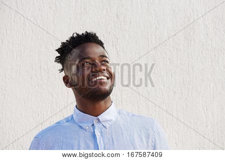 Attractive Man Laughing And Standing By Wall