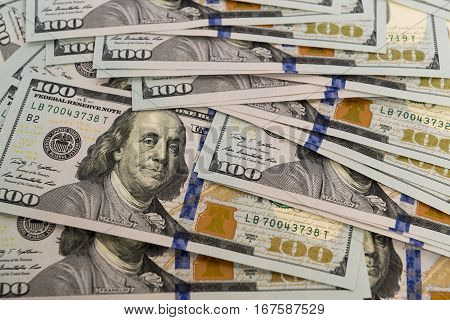 Heap of cash in hundred dollar banknotes