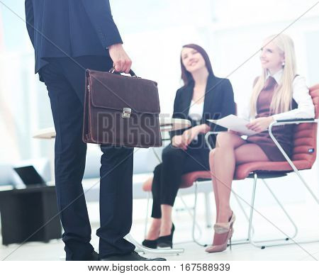 Close up portrait of a business man  with briefcase and collegue
