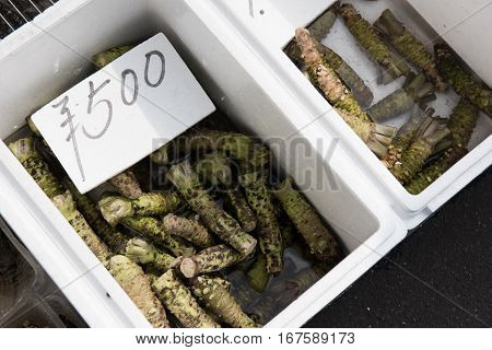 In this picture we can see a tag showing price of the wasabi vegetables kept inside the white box.
