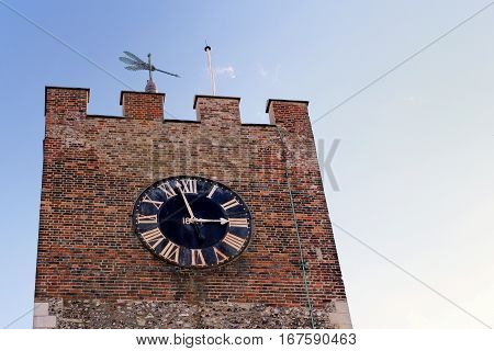 Clock tower and weather vane of an old church