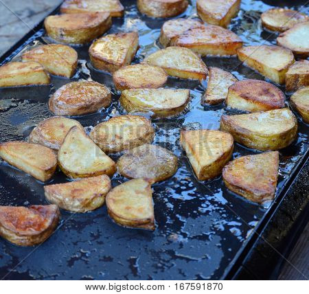 angled shot portable griddle breakfast potatoes cooking