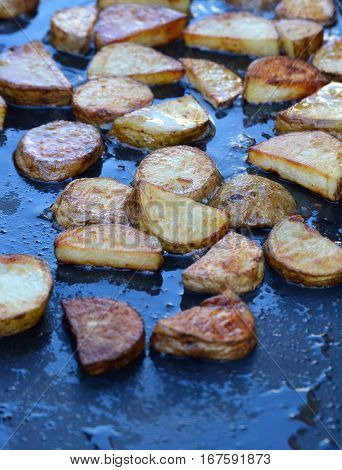 vertical shot portable griddle breakfast potatoes cooking
