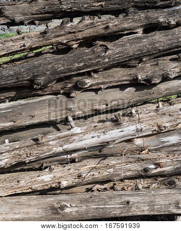 Wooden Log Fence Texture stacked up against hidden chain link