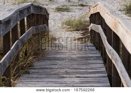Wooden Walkway On To Beach Along Florida Gulf Coast