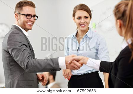 Picture showing manager introducing new worker to the team