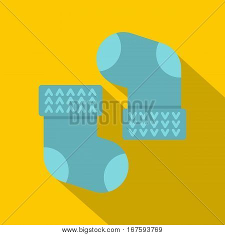 Pair of blue baby socks icon. Flat illustration of pair of blue baby socks vector icon for web on yellow background