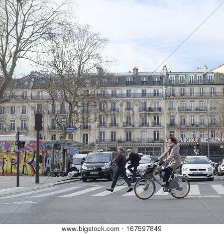 Paris, France, February 9, 2016: pedestrian cross road in a center of Paris, France