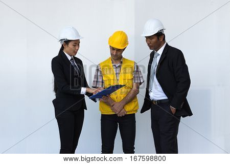 Woman engineer talking description construction plan in tablet listen to workers and man engineer on white background.