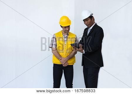 Engineer talking description construction plan in tablet listen to workers on white background.