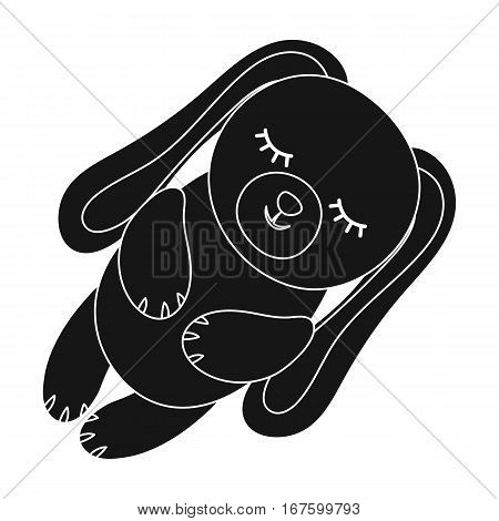 Toy rabbit icon in black design isolated on white background. Sleep and rest symbol stock vector illustration. - stock vector