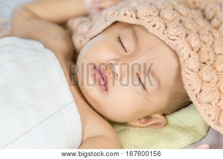 Baby Sleeping On Bed In The Bedroom