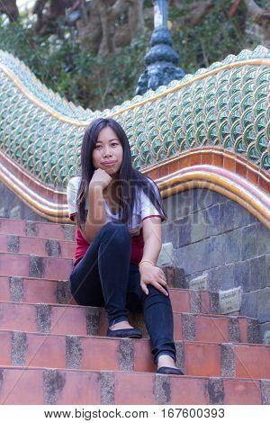Asia woman with naga staircase, Doi suthep Chiangmai Thailand