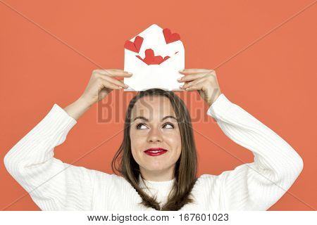 Woman holding envelope red paper hearts