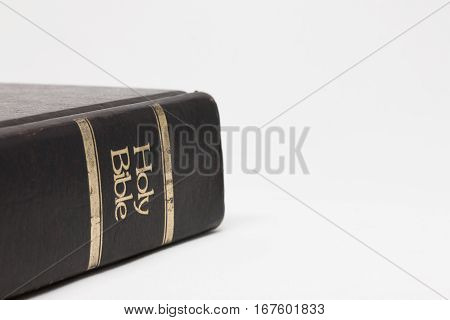 Close up of Old Holy Bible on table