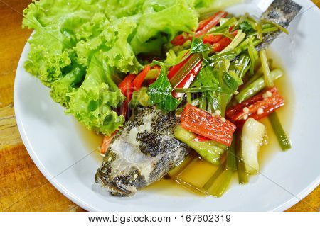 steamed sand goby fish with soy sauce on dish