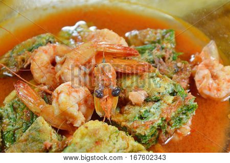 fried egg stuffed climbing wattle and shrimp in spicy sour soup on dish