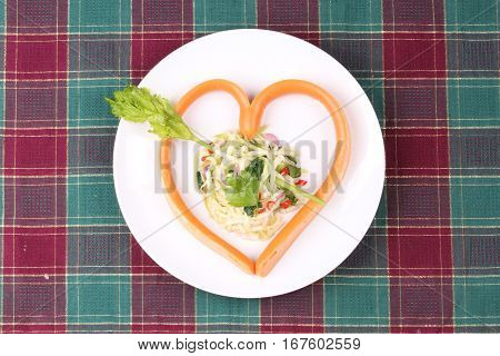 Sausage Cheese In Heart Style With Spicy Green Mango Salad.