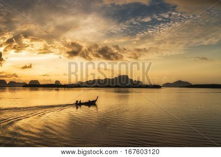 Silhouette Scene Of Long-tail Boat During Morning Sunrise In Phuket, Thailand.