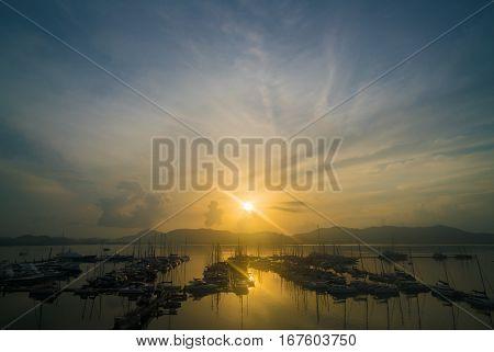 Yatch harbor in beautiful sunrise seascape. Golden light.