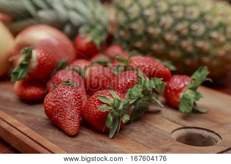 a close up look at fruit on a cutting board