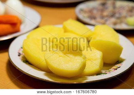 boiled potatoes on the table on a plate