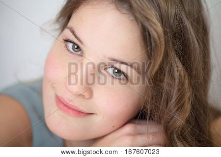 Young sensitive woman looking thoughtful at camera