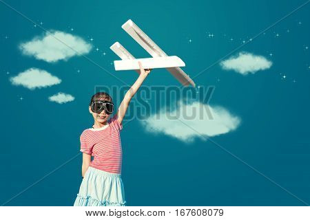 Cute Asian Girl Playing Toy Plane As Pilot Imagination To The Future.