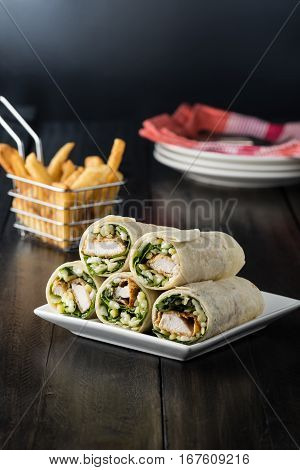 Breaded Chicken Burrito Wrap With Fresh Lettuce Cheese On Rustic Background