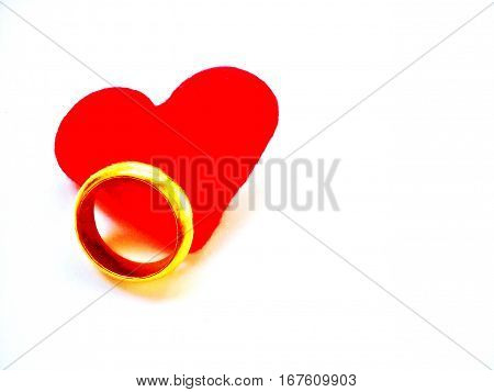 Heart and gold ring for Valentine's Day or Wedding's Day