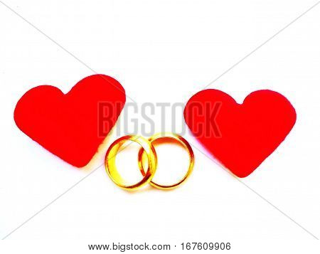 Heart and two gold rings for Valentine's Day or Wedding's Day