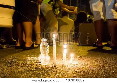 People With Candle Vigil In Darkness Seeking Hope, Worship, Prayer