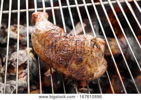Grilled Chicken Thigh Over Flames On A Barbecue