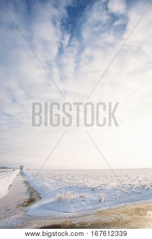 Winter Landscape With Rural Field And Sky