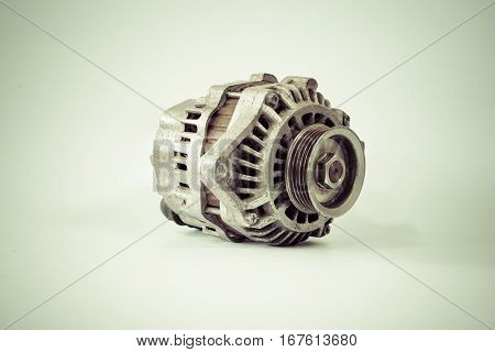 Old alternator for the car isolated on white background