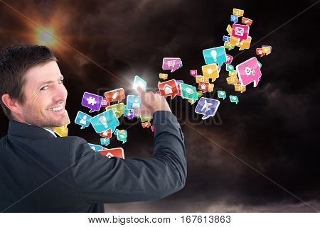 Businessman pointing with his finger against gloomy sky 3d