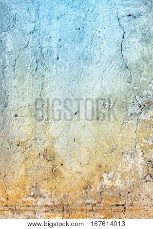 Grunge background with texture of stucco blue and ochre color