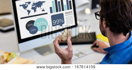 Computer graphic image of business presentation against high angle view of man working on computer